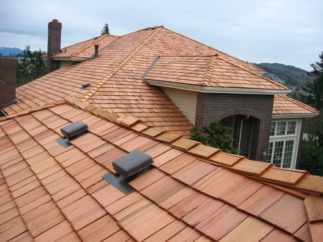 new cedar shake roofing on large upscale suburban home