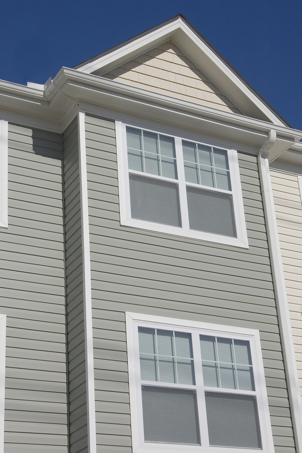 new vinyl siding installation on town home