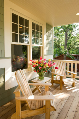 cozy home pine deck with Adirondack chairs on spring afternoon
