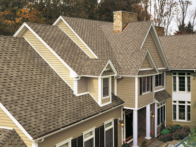 new asphalt shingle roofing on large upscale suburban home