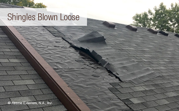 Shingles blown loose from roof